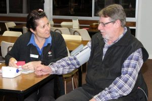 Nicole Schneider from West Wimmera Health Service checks Don Pedder's blood pressure